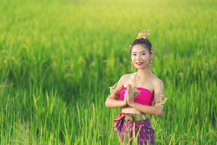 beautiful woman thai traditional outfit smiling standing-temple