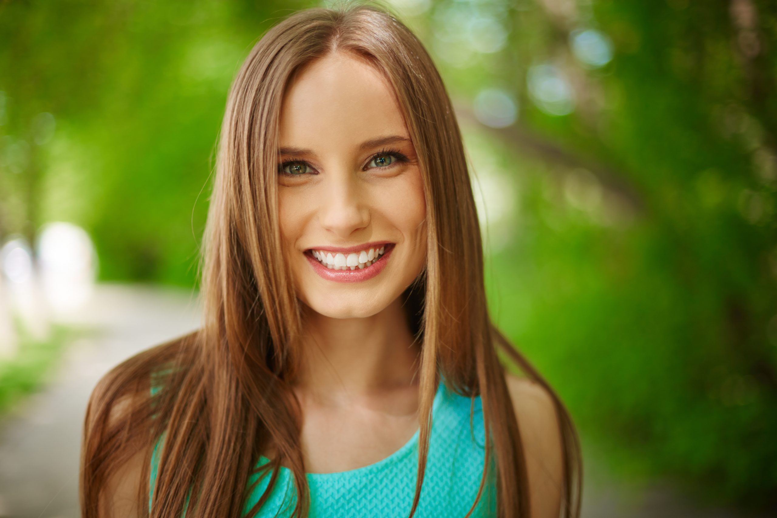 Belarusian smiling girl looking at camera outdoors