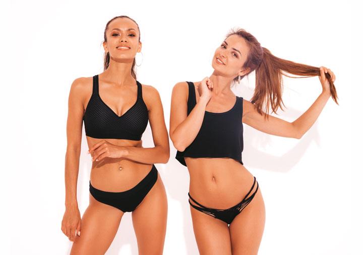two beautiful smiling sexy European women black lingerie